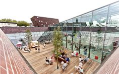 Image 1 of 24 from gallery of / bob-architektur BDA. Photograph by Nikolay Kazakov Brick Architecture, Architecture Details, Flood Areas, Mix Use Building, Glass Facades, Facade Design, Outdoor Landscaping, Commercial Design, Plaza