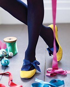 To liven up an old pair of flats, tie a thick satin ribbon around your foot before putting them on. Use a contrasting color or try some fun tights for a fresh look!