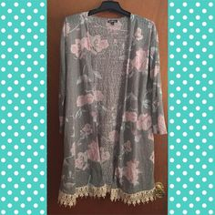 Faded Floral Kimono 100% polyester, very long and cute! Pretty faded, has a few picks but still good condition. Wear that is shown is supposed to look that way. 3/4 length sleeves. Crochet trim around the bottom Tops