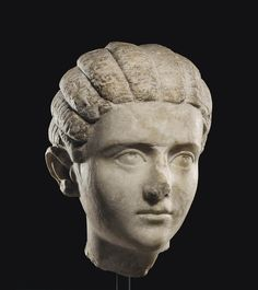A ROMAN MARBLE PORTRAIT HEAD OF A GIRL CIRCA LATE 2ND-3RD CENTURY A.D.    Christie's
