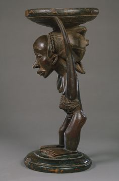 Africa | Royal stool from the Luba people of DR Congo | Wood and metal studs | Attributed to the Buli Master who was known to imbue his works with particular emotional intensity | ca. 19th century