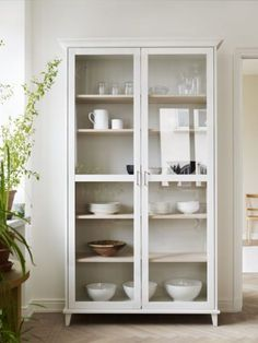 Example of wall of shelves. Two lots of these with glass or opaque doors. Width of pair of doors should be narrow 58 - 60 cm wide? (Eg: 30cm x2 plus 30cm x2 = 4 doors??) Height to back door = 206cm? Minimum 30cm (current 38cm, Grandma's dresser) deep shelves for dinner plates. Height of shelves is adjustable.