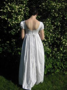 Regency era dress. Love the low back and the laces; so romantic!