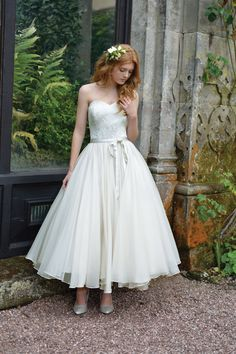 Skirt has wonderful drape. Pearl Orchid Bridal Gown: Ivory and Co.