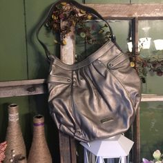 """NWT pewter Nine West hobo Pewter Hobo with brown lining.  NWT measures 13"""" wide x 11"""" tall. Nine West Bags Hobos"""