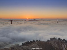 Sunrise over the fog covered Golden Gate Bridge. Nam Ing, local artist/photographer.