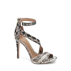 """VC SIGNATURE SARGENT- ASYMMETRICAL HIGH HEEL DRESS SANDAL-The Sargent introduces a whole new level of sexy with an unexpected curvy strap sweeping across the heel. Fair-colored snake adds enticing exoticism to the unabashed look. Slip on your favorite bodycon dress and wait for the compliments to pour in.   <li> 4"""" heel"""