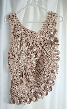 My distinctive version of the very popular crochet top that you see in boutiques and online. Wear as a sexy swimsuit cover up or add a little glam to a maxi dress or simple tank top. You can customize this pattern in so many ways, the possibilities are endless.