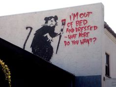 Banksy - I'm out of bed and dressed what more do you want? - http://weareyourfriend.nl/banksy-vrijheid-in-beeld/