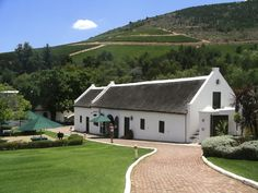 Stellenbosch in the Western Cape Province of South Africa. A lot of the houses are old Cape Dutch architecture. This is the capital of the Cape Winelands. Thatched House, Thatched Roof, Provinces Of South Africa, Cape Dutch, African House, Simple House Plans, Dutch House, Dutch Colonial, Cabins In The Woods