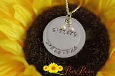 """❤ SISTERS NECKLACE DESCRIPTION: Custom hand-stamped double disc necklace with """"Sisters"""" stamped on the top disc and 2 names on the bottom disc. Design by Pretty Prairie Designs.   ❤ DISC SIZES/MATERIALS: The discs are stainless steel and won't tarnish or fade. The bottom disc is 1 1/4"""" and the top disc is 1"""". Comes with 2 hand wrapped pears (white and pink). #sistersnecklace #handstampedjewelry #pearlcharms"""