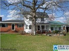 This historical home is over 100 years old with much character and charm.   Kitchen has been totally updated. Features fireplace in living Room. Sunroom and storm shelter off patio. 17.4+/- acres per survey. In City  limits. Beautiful rolling pasture land.