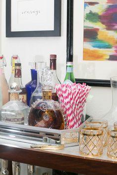Kristin Jackson's Atlanta Home Tour // bar cart // styling // gold glasses // paper straws // #drinks #decor #bar // Photography by Amanda Coker, Dash Photography
