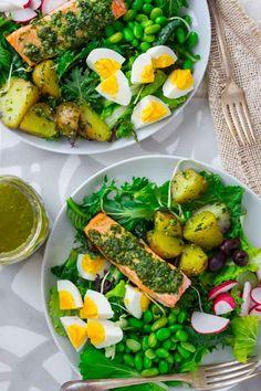 Pesto salmon and edamame salad nicoise with hard boiled eggs, olives, potatoes and radishes
