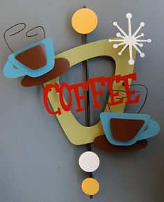 http://stevecambronne.com/2010_COFFEE_1.jpg.  Yes, coffee makes me smile.  So does this wall art.