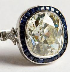 Art deco 3.20 ct cushion-cut diamond & French-cut sapphire target ring, platinum setting