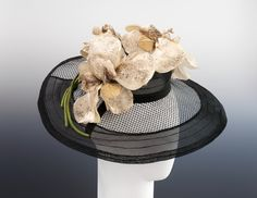 An incredibly classy Schiaparelli hat made of woven horsehair net and decorated with silk irises, Fall-Winter 1939.