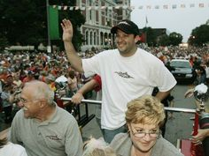 Tony Stewart and his parents ride a fire truck during