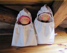 dolls in sleeping bags