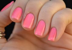 A classic coral pink with a subtle spatter of sparkles at the tip are perfect for summer.