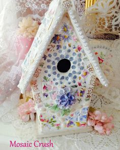 gems and jewels adorn this sweet mosaic birdhouse! www.facebook.com/mosaiccrush