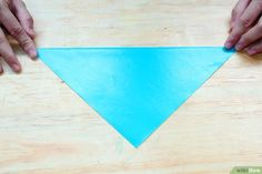 How to Make an Origami Sailboat. Interested in adding a sailboat decoration to your desk, or perhaps creating a gift tag? This article sets out how to make an origami sailboat which you can use in many different ways. Origami Sailboat, Sailboat Decor, How To Make Origami, Origami Art, Gift Tags, Paper, Pictures, Crafts, Photos