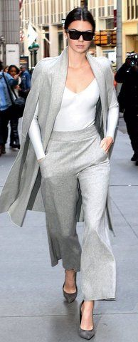 Kendall Jenner wears In an Atea Oceanie bodysuit and Sally LaPointe cape and pants