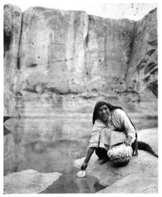 Woman filling olla with water, Acoma Pueblo, New Mexico  Photographer: Ina Sizer Cassidy? Date: 1930-1940? Negative Number 030784
