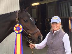 Off the track - Feather and owner/rider Scotty Sherman took home a hunter championship last Friday, beating a field of fancy Warmbloods!