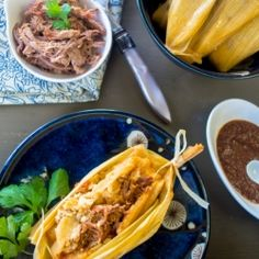 Buttery & Spicy Tamales Made Irresistible with Smoked Brisket and Cashew Nut Mole.