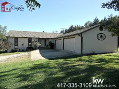 #KellerWilliams #RealEstatae #Branson 425 Redbud Call the Crispin Team at 417-335-3109. OFFICIAL LISTING AGENT. A great find, only 5 minutes from Table Rock Lake & College of the Ozarks. Ranch style home, sitting on a hard to find level, .68 acre private lot. The living room features wood flooring, vaulted ceiling, fireplace and recessed lighting. Kitchen is large & open with built-in desk, & extra large pantry. Huge family room with bonus office, large master suite with walk-in closet.