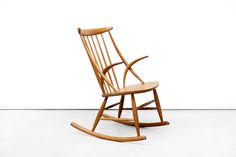 Illum Wikkelsø oak rocking chair for sale at OUR vintage design Amsterdam