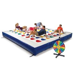 Inflatable Twister!!! I want this so bad...  This is the inflatable outdoor game that challenges up to 10 players to touch different colored dots on a playing surface using only their hands and feet. THIS WOULD BE SO AWESOME.