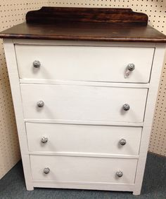 Chest of drawers painted white with stained top at Homestead Handcrafts, San Antonio, Texas