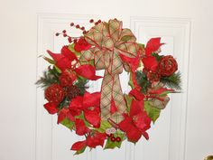 Christmas wreath.pointsetas and plaid burlap ribbon