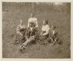 African American family posed for portrait seated on lawn, W. E. B. Du Bois, collector, 1899 or 1900.