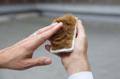 "The fur phone: signals, such as an incoming call, cause the fur to stand up: it can convey information very subtly and ""naturally"".  http://www.denkwerk.com/2013/07/10/a-plea-for-timid-technology-part-3/"