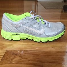 Nike Dual Fusion Sneakers/Running/Tennis Shoes only worn twice because they were too big for me.. super cute light grey/silver sneakers with neon green/yellow and white details! will post more pics later Nike Shoes Sneakers