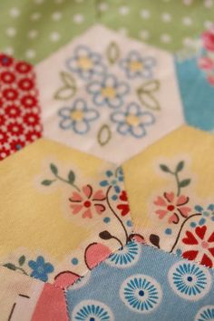 love the embroidered flower hexy in the pattern of the vignette hexagon quilt - and replace one with your (embroidered) name and the year you started the quilt!
