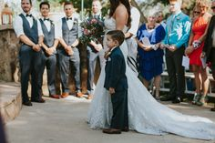 The son walked his mom down the aisle.