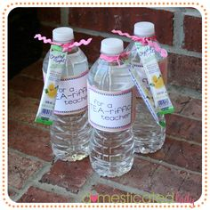 Bands of printed cardstock, wrapped them around a regular ol' water bottle, and tied a little individual powered drink pack on the top (tea to go with the label). Change it up to say a TEA-riffic Volunteer or Person or Friend. <3