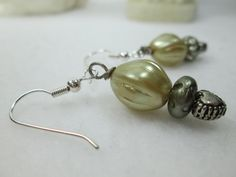 ARE YOU LOOKING FOR A ROMANTIC PAIR OF EARRINGS FOR A SPECIAL OCCASION?  THESE BEAUTIFUL ART DECO STYLE, PASTEL GREEN EARRINGS MADE WITH ACRYLIC BEADS, TINY METAL HEARTS AN...