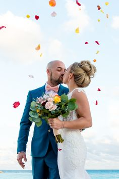 """Vickie and Daniel's destination wedding in Cancun was simply stunning. Click the link to see all of the details from their big day, from their oceanfront """"I do's"""" to their magical poolside reception.  Photo credit: Cristina Gisselle Gonzalez Flores"""