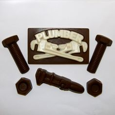 "This Yummy Chocolate Plumber set includes: a ""Plumber"" chocolate, a pipe wrench, and filled with nuts and bolts!"