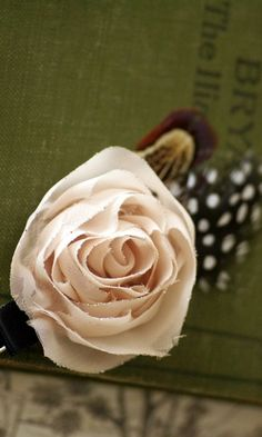 cloth flower pin with feathers