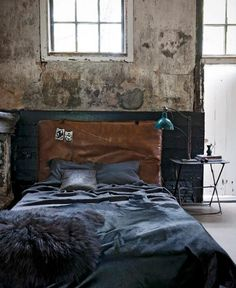 Color palette: weathered wall, leather headboard, bedding & lamp. http://media-cache-ak1.pinimg.com/originals/10/ee/cf/10eecf8a3d6aed7947cba59f8cc95178.jpg