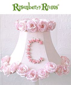 The Personalized Monogram Pink Lamp Shade with Roses is personalized with dainty roses to reflect your little girl's initial!  This bell-shaped scalloped shade is made of the finest pink Dupioni silk and trimmed with stunning pink Mulberry paper roses