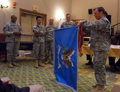 LTC Biggerstaff of 532nd MI accepting the award and streamer for the 2013 BN Volunteer of the Quarter from CSM Purnell on April 16, 2013