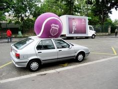 Giant tennis ball crushes car.Out-of-home advertising is so creative! Pinned by Spark Strategic Ideas www.sparksi.com