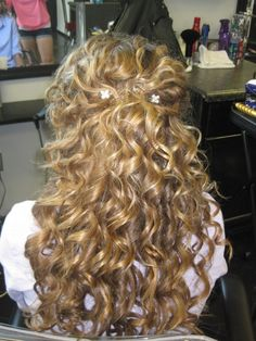 Naturally curly half-up updo... Prom??